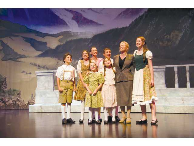 "Maria (second from right, played by Jill Kocalis Scott) and the von Trapp children sing in ""The Sound of Music."""