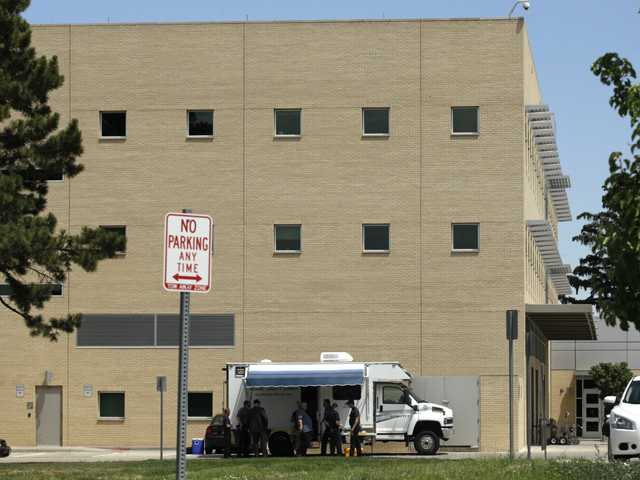 Members of the Adams County Sheriff's Dept. Hazardous Devices Unit are seen parked as they search the Campus Services building on the University of Colorado-Denver's Anschutz Medical Campus on Monday in Aurora, Colo., after reports of two suspicious packages were made on the campus. James E. Holmes, who is being held on suspicion of first-degree murder stemming from a mass shooting at an Aurora movie theater last Friday, is a former student in the school's Ph.D. program in neuroscience.