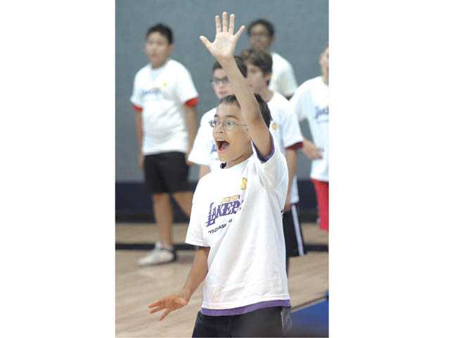 "Timothy Stayman, 10, shouts ""shot"" as he runs a defensive drill at the Lakers Youth Foundation basketball clinic held at the Boys & Girls Club in Newhall on Thursday."