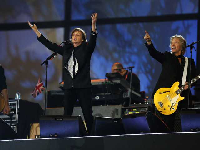 Paul McCartney, center, performs during the Opening Ceremony at the 2012 Summer Olympics on Saturday in London
