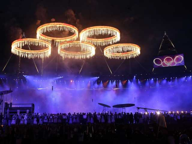 The Olympic rings are lit with pyrotechnics during the Opening Ceremony at the 2012 Summer Olympics, Friday, July 27, 2012, in London.