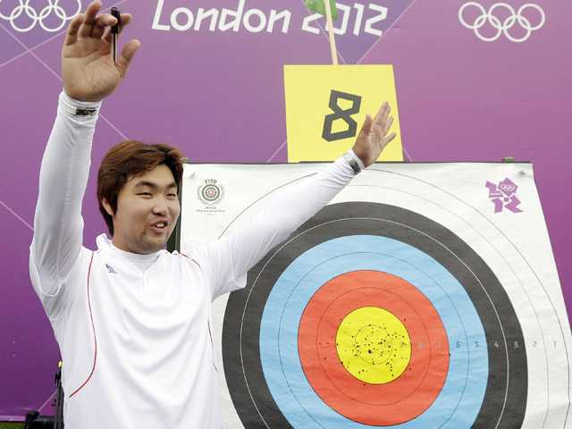 South Korea's Im Dong-hyun celebrates his world record during an individual ranking round at the 2012 Summer Olympics on Friday in London. Dong-hyun set world record in the round with a 699 score.