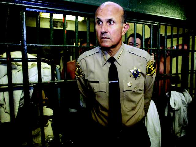 Los Angeles County Sheriff Lee Baca tours the Men's Central Jail in Los Angeles on May 19, 2004. The Los Angeles County Sheriff's Department has been accused of hiding details of deputy assaults on inmates, but also has had to scrap a questionable program where official-looking badges were given to local civic leaders.