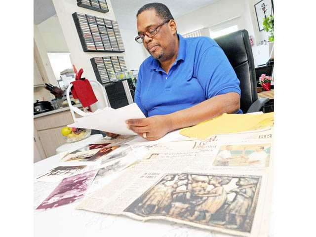 Goodwyn looks through family documents.