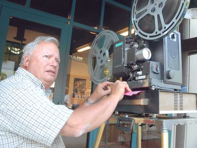 Film historian David Shephard gets ready to roll film at the annual Silents Under the Stars fundraiser for Hart Park.