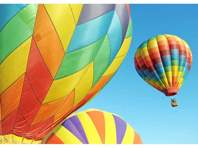 Hot air balloons are launched over Santa Paula to start the second day of the Citrus Classic Balloon Festival on Saturday.