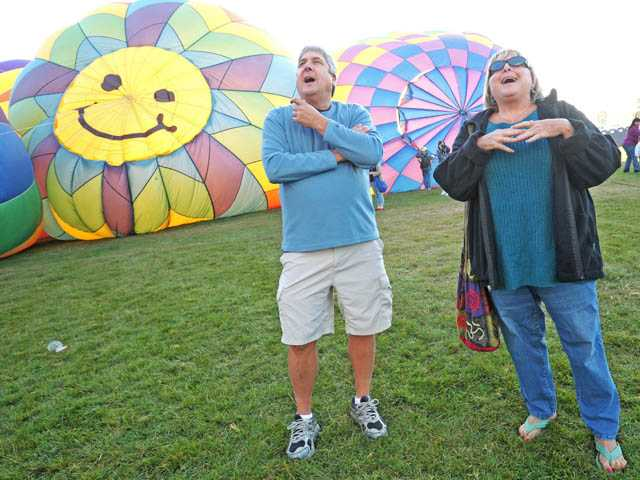 Ken Kowal, of Oxnard, left, and Claudia Wells, of Ventura, marvel at balloons.