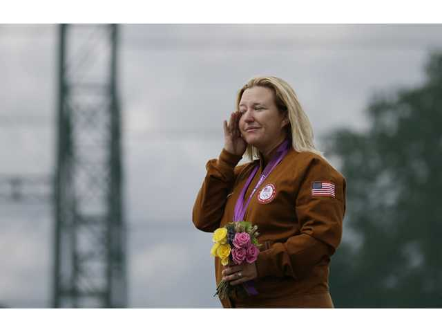 Olympics: Rhode's drive for 5 capped by skeet gold medal