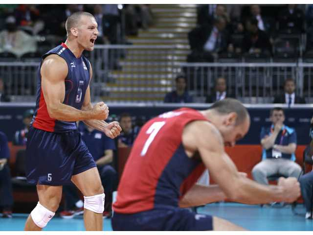 United States player Richard Lambourne, left, and teammate Donald Suxho celebrate scoring a point against Serbia during a men's preliminary volleyball match at the 2012 Summer Olympics, Sunday in London.