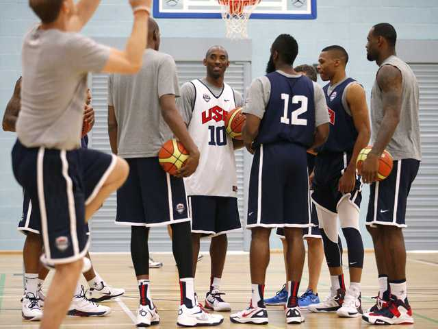 United States players, from right, LeBron James, Russell Westbrook, James Harden (12), Kobe Bryant (10) and Kevin Durant gather for a men's team basketball practice at the 2012 Summer Olympics on Saturday in London.