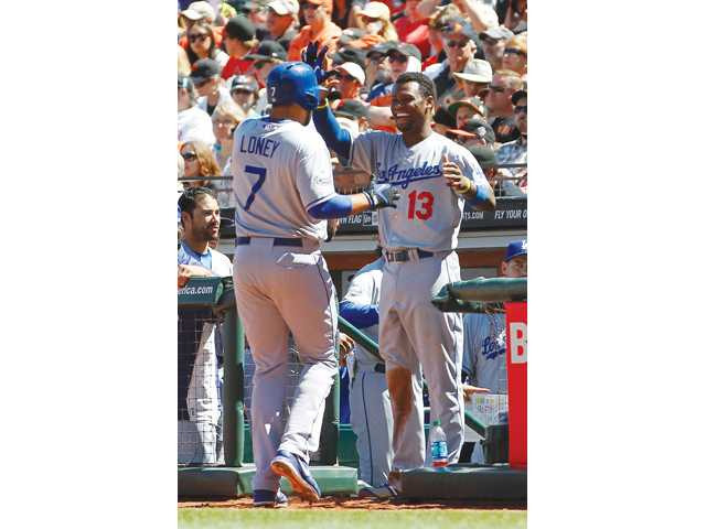 Los Angeles Dodger James Loney (7) is congratulated by Hanley Ramirez (13) during a game against the San Francisco Giants in San Francisco on Sunday.