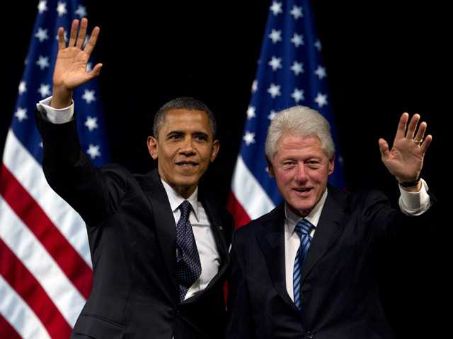In this June 4, 2012 file photo, President Barack Obama and former President Bill Clinton wave to the crowd during a campaign event at the New Amsterdam Theater in New York