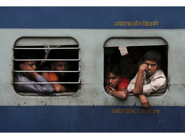 Indian stranded passengers wait inside a stalled train as they wait for the services to resume after a power outage in New Delhi, India on Tuesday.