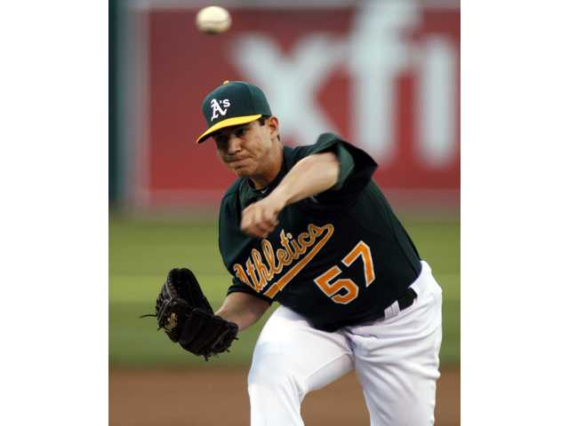 Oakland Athletics pitcher Tommy Milone, a Saugus High alum, throws to the Tampa Bay Rays on Tuesday in Oakland.