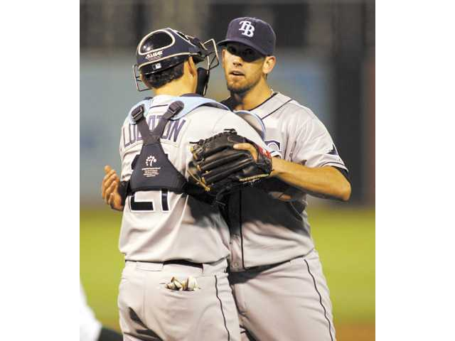 Tampa Bay Rays pitcher and Hart High graduate James Shields hugs catcher Jose Lobaton after pitching a complete-game, three-hit shutout, 8-0, against the Oakland Athletics on Tuesday in Oakland.