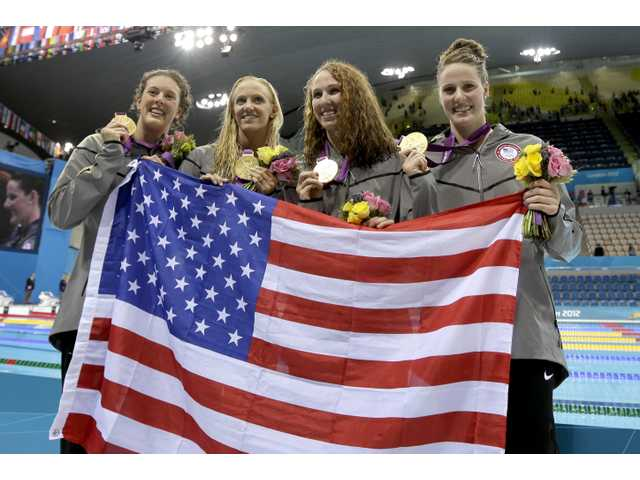 From right, United States' Missy Franklin, United States' Dana Vollmer, United States' Shannon Vreeland and United States' Allison Schmitt pose with their gold medals for the women's 4x200-meter freestyle relay swimming final at the Aquatics Centre in the Olympic Park during the 2012 Summer Olympics in London on Wednesday.