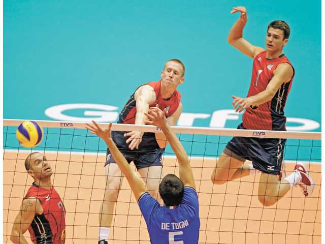 Saugus graduate David Smith and the United States men's volleyball team compete today against Russia.