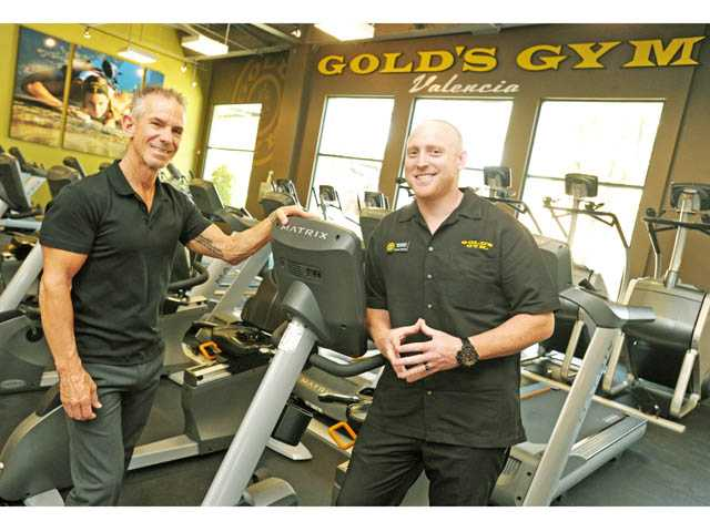 President and CEO Angel Banos, Jr., left, and general manager Brandon Goldstein survey the cardio area of the new Gold's Gym location in Valencia on Wednesday.