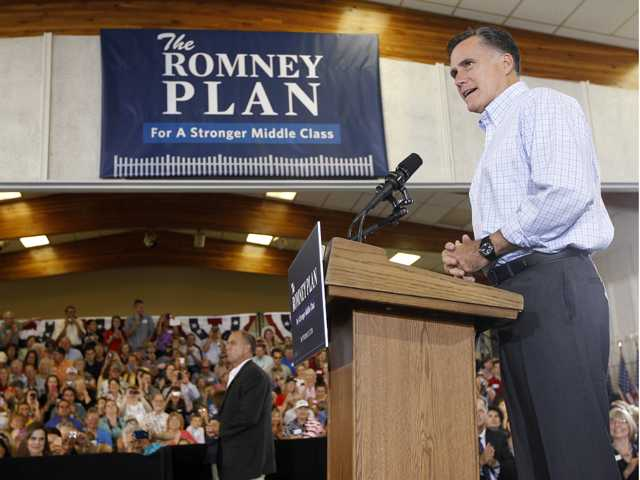 Republican presidential candidate, former Massachusetts Gov. Mitt Romney campaigns at the Jefferson County Fairgrounds in Golden, Colo., Thursday.