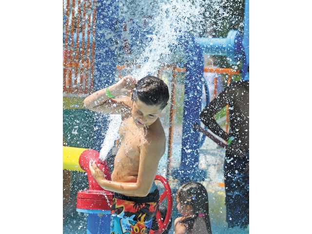 Jon Etrio cools off in the activity pool at the Santa Clarita Aquatic Center in June.