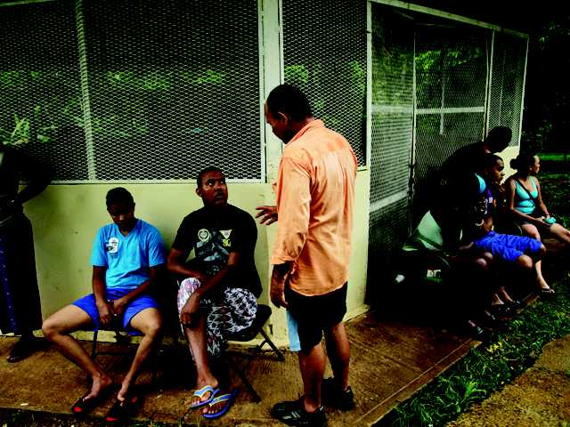 Cuban migrant Mayra Reyes, sitting fourth from right, gathers on July 3 with other Cubans with whom she traveled as they rest at a shelter along with another group of migrants from Bangladesh, after being found by Panamanian border police in the Darien province in Meteti, Panama. Panamanian authorities began noticing five years ago that the Darien Gap, the only interruption in the Pan-American Highway, was being used by migrant smugglers, usually to move people from Asia and Africa.