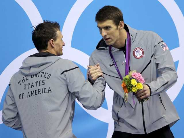 United States' gold medal winner Michael Phelps shales hands with teammate and silver medalist Ryan Lochte after the medal ceremony for the men's 200-meter individual medley swimming final at the Aquatics Centre in the Olympic Park during the 2012 Summer Olympics in London, Thursday.