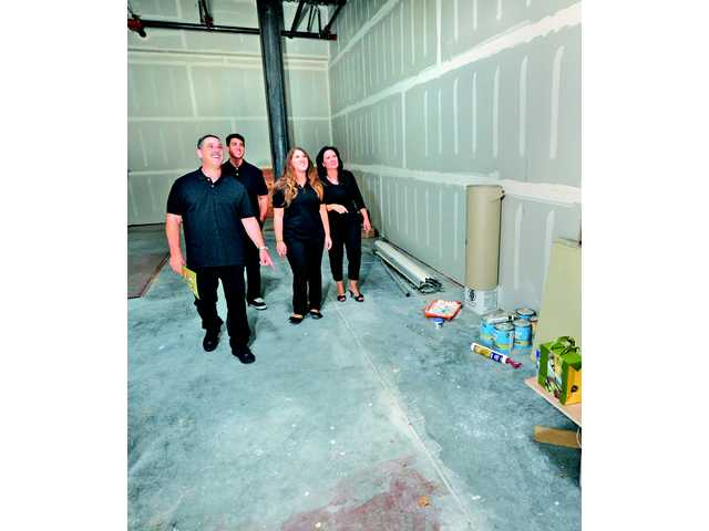 The Levinson family tours the space where Oil & Vinegar will locate prior to construction of the interior of the store. (L to R) Richard Levinson, Brandon, Amanda and Lynn.