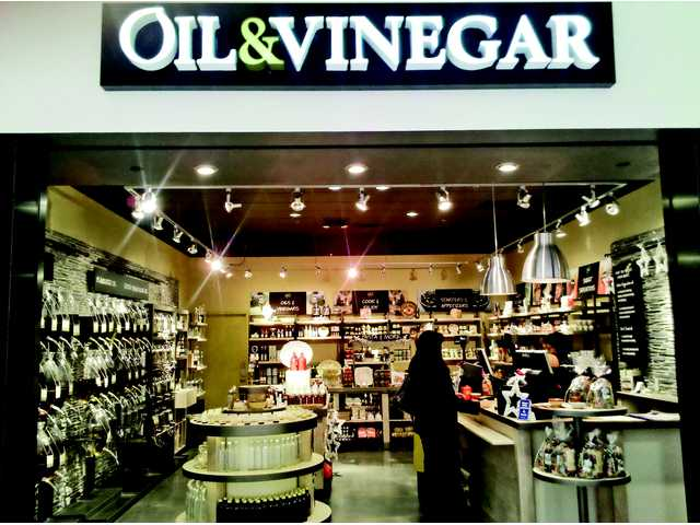 A photograph of another Oil & Vinegar location is seen.