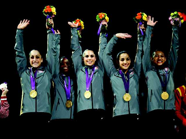 U.S. gymnasts, top left to right, Jordyn Wieber, Gabrielle Douglas, McKayla Maroney, Alexandra Raisman and Kyla Ross raise their hands on the podium during the medal ceremony during the Artistic Gymnastic women's team final at the 2012 Summer Olympics on Tuesday in London. Team U.S. won the gold.