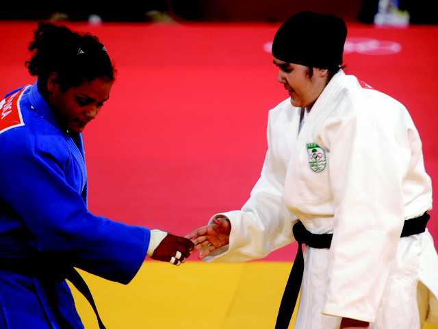 Saudi Arabia's Wojdan Shahrkani and Puerto Rico's Melissa Mojica compete during the women's 78-kg judo competition at the 2012 Summer Olympics, on Friday in London.
