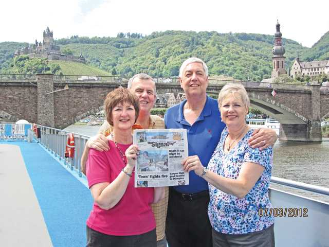 Patti Kreis, left, Doug Kreis, Curtis Bates and Jane Bates standing on the sundeck of the AmaWaterways AmaDolce at Reichsburg Castle in Cochem, Germany, on July 3.