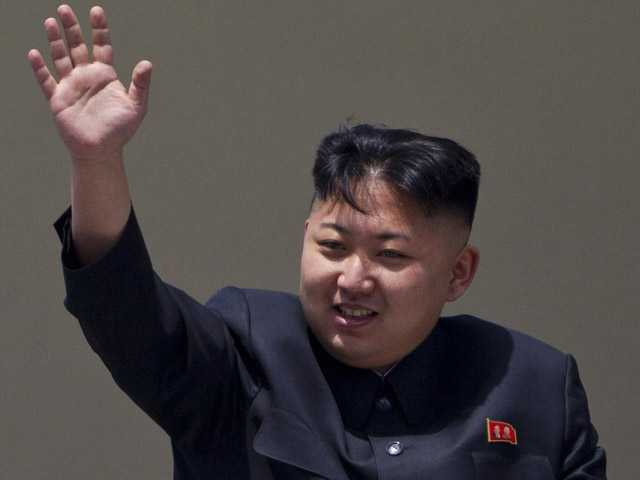 North Korean leader Kim Jong Un waves from a balcony at the end of a mass military parade in Pyongyang's Kim Il Sung Square on April 15.