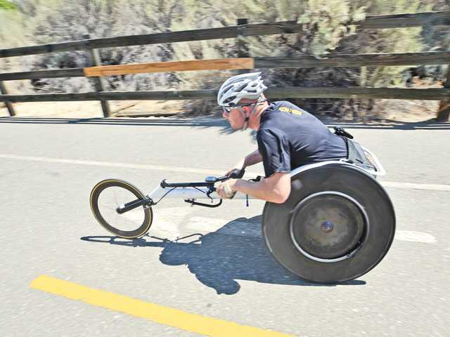 "Kevin Mather is a 2000 Valencia High graduate. The paraplegic athlete was recently featured in a commercial for Nike called ""Find Your Greatness."" He will compete in the Ironman World Championship in Kona, Hawaii Oct. 13."