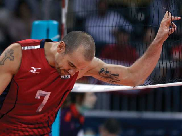 The United States' Donald Suxho reacts after a score by Russia during a men's preliminary volleyball match at the 2012 Summer Olympics on Saturday in London. Russia won in five sets.