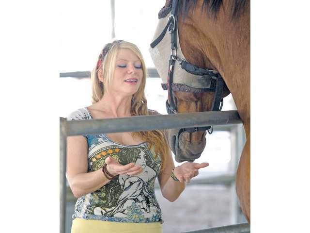 Animal Communicator Amanda Riester channels Sir Lancealot at The Gentle Barn on Wednesday.