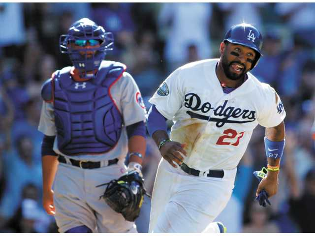 Los Angeles Dodgers' Matt Kemp, right, celebrates as he runs towards Hanley Ramirez after he scored on a walk off single by Ramirez and Chicago Cubs catcher Welington Castillo, left, walks off the field during the bottom of the ninth inning of a baseball game on Sunday in Los Angeles. The Dodgers won 7-6.