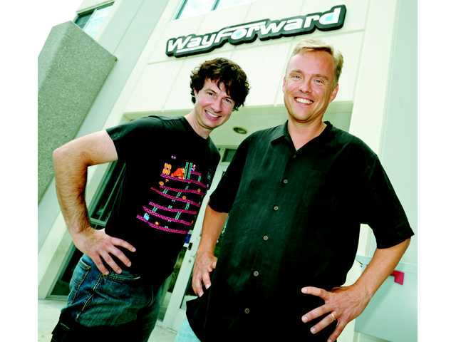 Voldi and Beck in front of their Valencia video game studio July 13.