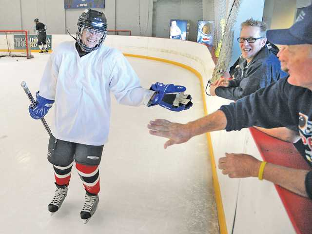 Jessica Honnen, left, celebrates after scoring a goal during practice at Ice Station Valencia on Saturday.
