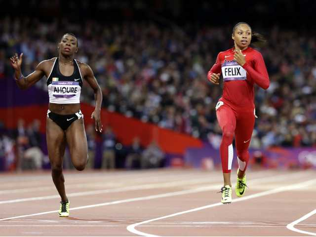 United States runner and Santa Clarita resident Allyson Felix, right, leads Ivory Coast's Murielle Ahoure in the women's 200-meter semifinal on Tuesday in London.