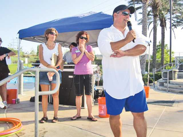 Martin Rodriguez, right, Single Mothers Outreach board member, addresses guests at the SCV Pool Party fundraiser.