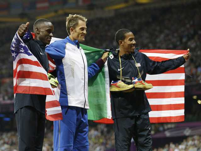 From left: United States' Will Claye, silver, Italy's Fabrizio Donato, bronze, and United States' gold medal winner Christian Taylor, celebrate after the men's triple jump final in London on Thursday.