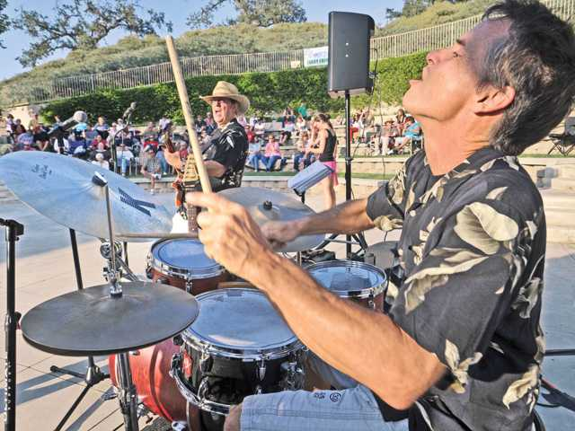 Dwight Kennedy Band drummer Richard Fultineer, right, performs classic rock favorites for the crowd at the Valencia Marketplace Shopping Center Amphitheater in Valencia on Aug. 3. This Friday's concert will feature a Southern California Beach classics band, The Hodads, and runs from 6-8 p.m in the amphitheater.
