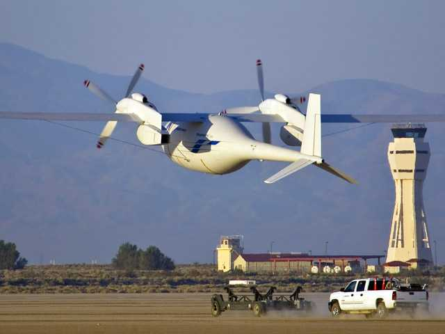 In this June 1 photo, the new Boeing Phantom Eye unmanned drone, designed to stay airborne for days, takes off on its first autonomous flight at Edwards Air Force Base.