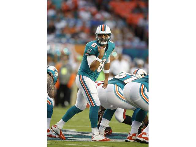 Miami Dolphins and Hart graduate Matt Moore warms up before a game against the Tampa Bay on Friday in Miami.