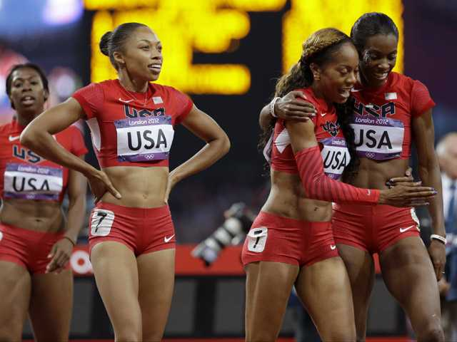 United States' women's 4 X400-meter relay team from left, Francena McCorory, Allyson Felix, Sanya Richards-Ross and Deedee Trotter celebrate in the Olympic Stadium in London on Saturday.