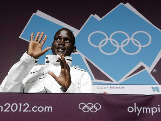 Marathon runner Guor Marial, who is stateless, appears during a news conference on Friday at the 2012 Summer Olympics, in London. Marial, from South Sudan, will compete in the marathon under the Olympic flag.