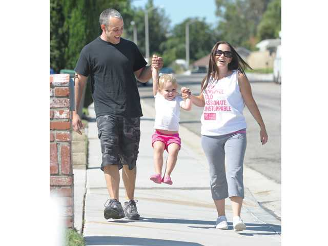 The Brandes family takes a walk around their Valencia neighborhood in preparation for Nikki's September walk in the Avon Walk for Breast Cancer in Santa Barbara.