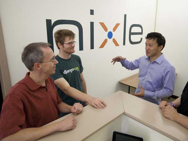 From left, Joe Rantala, software developer, Patrick Boyd, vice-president of engineering, Eric Liu, CEO and Charles Choy, director of quality assurance gather for a discussion at the offices of Nixel in San Francisco.