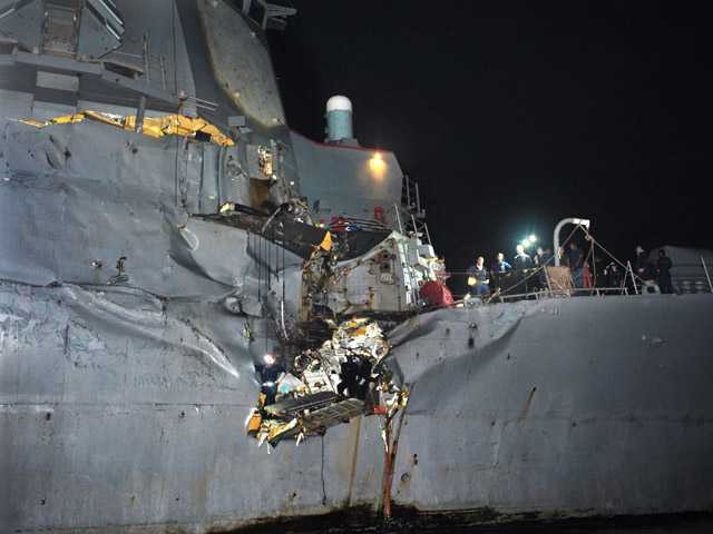 The U.S. Navy's guided-missile destroyer is seen damaged after it collided with a Japanese-owned oil tanker just outside the strategic Strait of Hormuz on Sunday