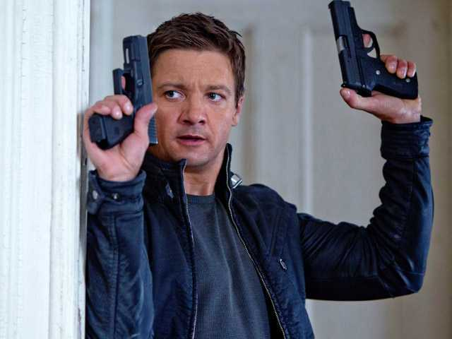 "This publicity film image released by Universal Pictures shows Jeremy Renner, as Aaron Cross, in a scene from ""The Bourne Legacy."""